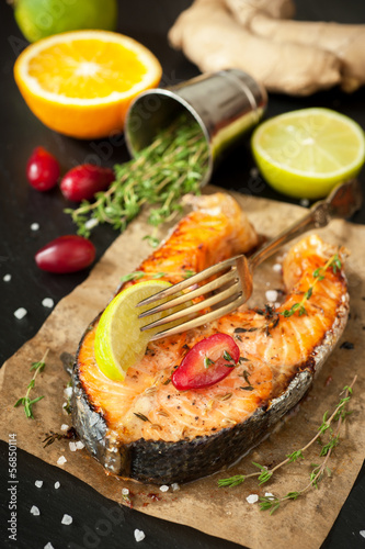 Baked fish salmon with lemon and thyme on the chalkboard