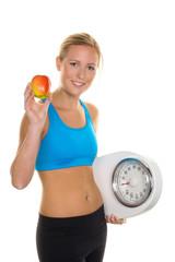 Frau mit Apfel und Waage