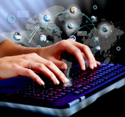 Hands with a computer keyboard.