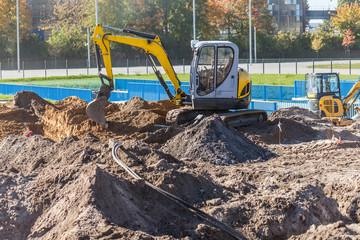 Mini excavator on a construction site