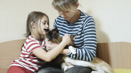 Mother, daughter and pets, close-up