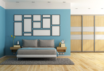 Blue modern bedroom with double bed and wardrobe