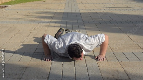 Fat man trying do push-ups