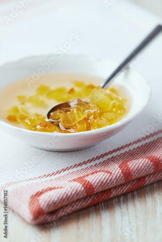 Orange jam in a small bowl