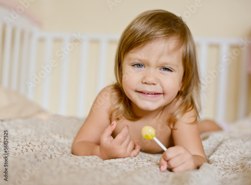 toddler with lollypop