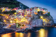 Scenic night view of colorful village Manarola in Cinque Terre - 56857758