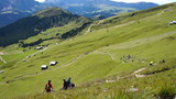 Mountain biking down - people downhill on bikes, Dolomites