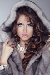 Beauty Fashion Model Woman in Mink Fur Coat. Winter Girl in Luxu