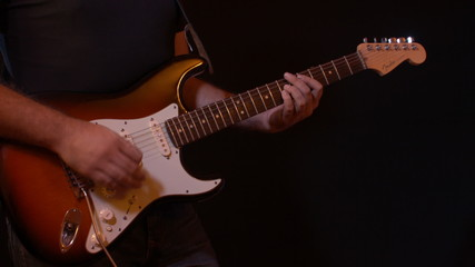 Electric Guitar Player  Black Background Recording Studio