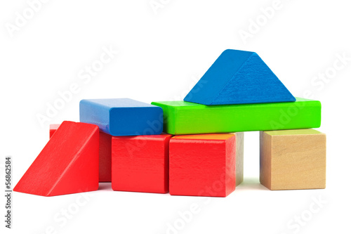 Wooden toy colorful bricks isolated on white background.