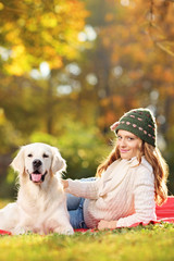 Young female with her dog in park