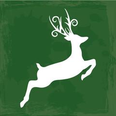 Weißes Rentier springt auf grünem Hintergrund