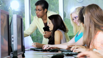 IT College Students Working with African American Tutor