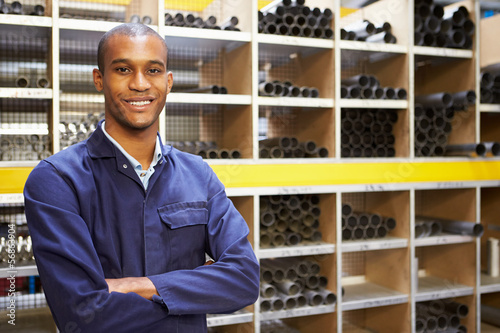 Portrait Of Engineering Worker In Store Room