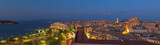 Panoramic shot of the citylights of Corfu city at night. Kerkyra