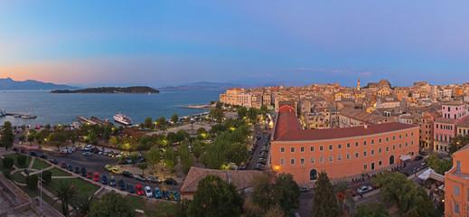 Panoramic shot of Corfu city with blue cloudy sky. At sunset. Ke