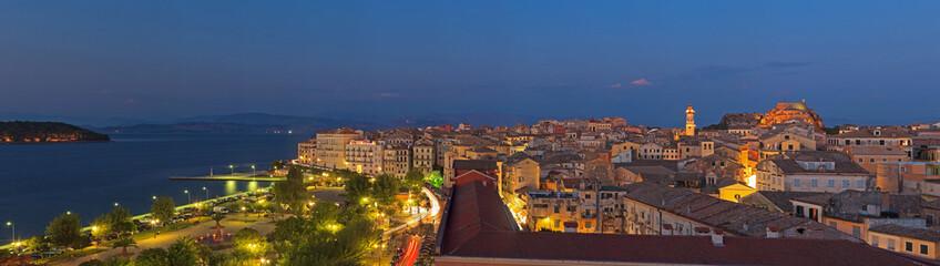 Panoramic shot of the citylights of Corfu city at night. Kerkyra