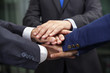 Business team showing union with their hands together forming a