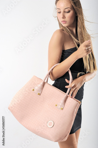 Beautiful belonde girl with pink bag