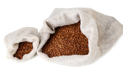 Cloth bags with buckwheat isolated on white