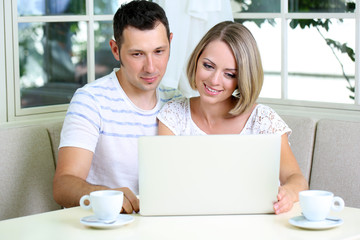 Young couple  with laptop, at home