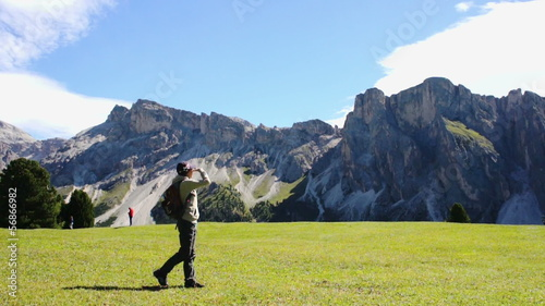 Young tourist with backpack enjoying valley view