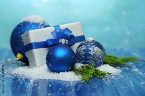 Composition with Christmas balls, gift box and snow