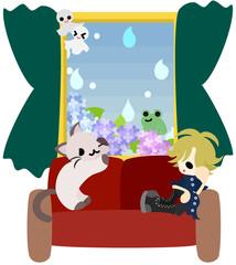 雨が降る日、ソファに腰掛け窓の外を眺めながら退屈そうにしている女性と猫。