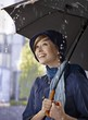 Happy young woman in the rain