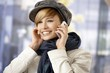 Attractive woman talking on mobile wintertime