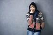 Happy young woman in scandinavian sweater