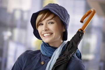 Attractive young woman holding umbrella
