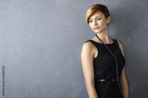 Dreamy young woman in black dress