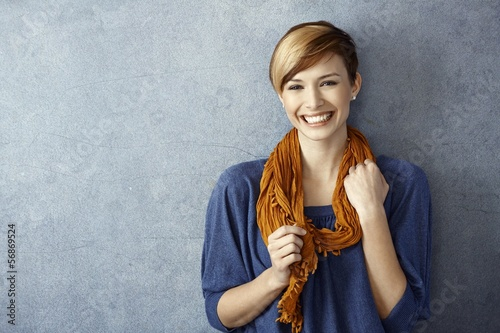 Young woman smiling happily