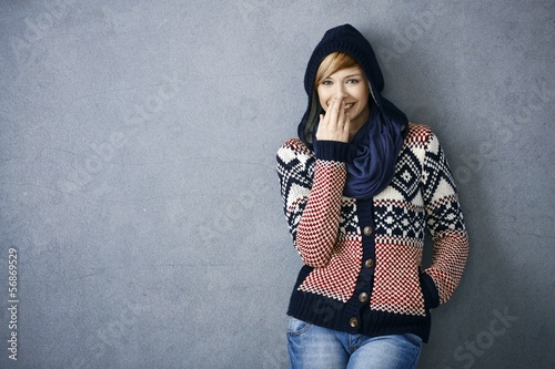 Happy young woman in scandinavian sweater