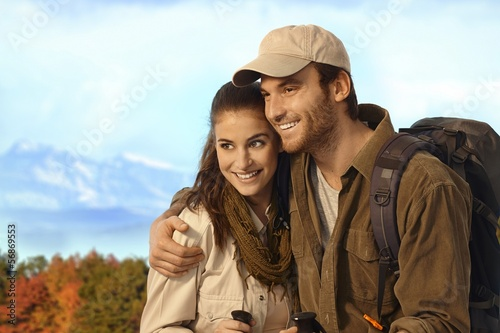Couple hiking in autumn scenery