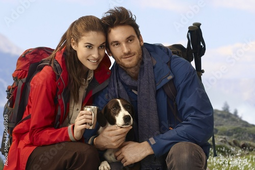 Happy hikers with dog