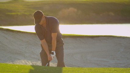 Male Golfer Playing Out Sand Bunker