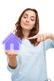 Beautiful woman holding a house sign on her palm