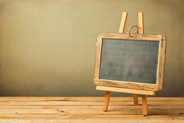 Chalkboard on wooden easel on wooden table