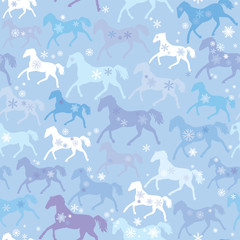 Seamless pattern with wild horses and snowflakes on winter light