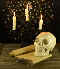 Candelabra with skull and scroll