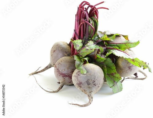 bunch of ripe red beets with green leaves