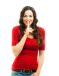 Smiling woman dressed in red doing a silence sign
