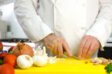 Chef hands with garlic
