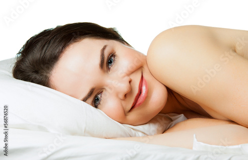 Content smiling woman in bed