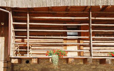 Balcony on Wood and Stone Farm Building