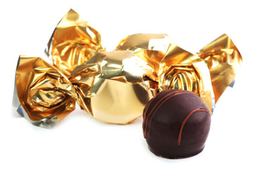 Chocolate candy in golden wrapper