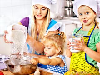Mother and grandchild baking cookies.