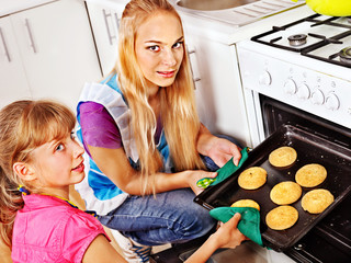 Mother and daughter bake cookies